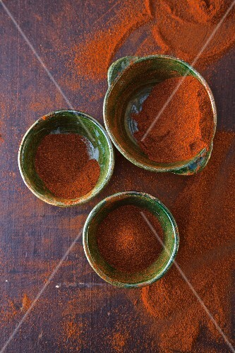 Three bowls of chilli powder (seen from above)