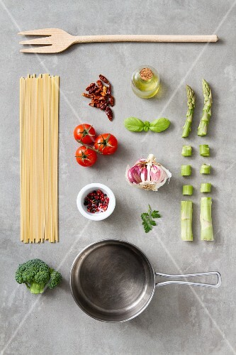 An arrangement of kitchen utensils and ingredients for pasta dishes