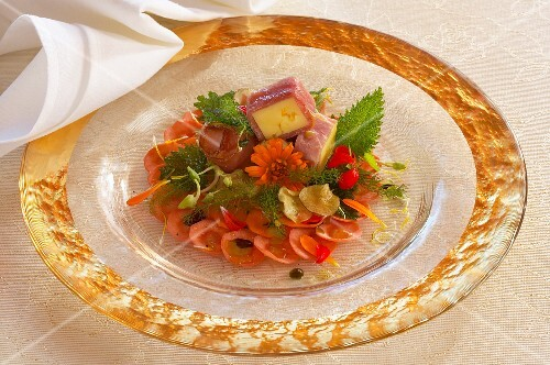 Cheese in ham on carrot carpaccio