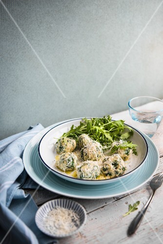 Spinach and ricotta gnocchi with Parmesan cheese and rocket