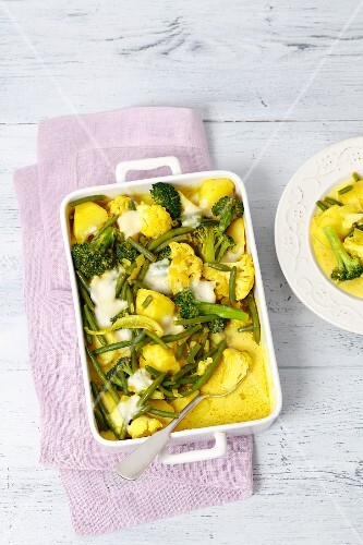 Vegetable bake with mozzarella and turmeric in a baking dish