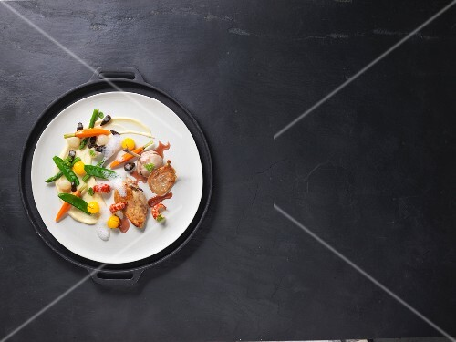 Sous-vide spring chicken with crayfish tails and colourful vegetables