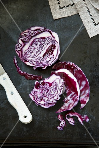 Sliced red cabbage and a knife