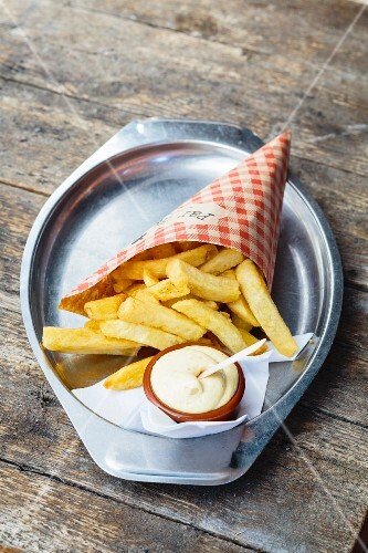 Chips in a cone with mayonnaise