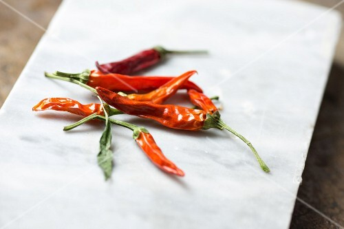 Red chilli peppers on a white platter