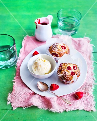 Raspberry muffins and vanilla ice cream served with raspberry sauce
