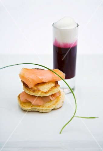 Mini bilinis with smoked salmon and a beetroot cappuccino