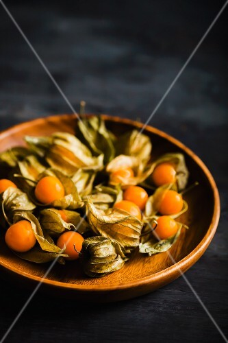 Physalis in a wooden bowl