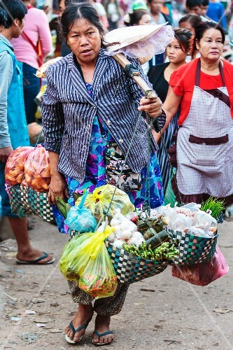 A street seller at a market in Vientiane, Laos