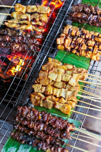 Various meat skewers on a grill Vientiane, Laos
