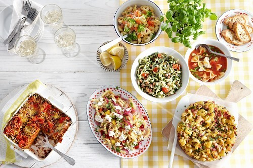 Various pasta dishes on a table