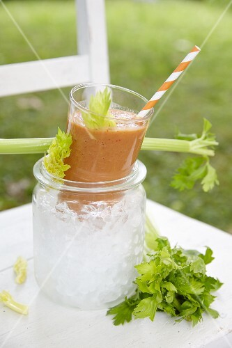 A vegetable smoothie on a garden chair