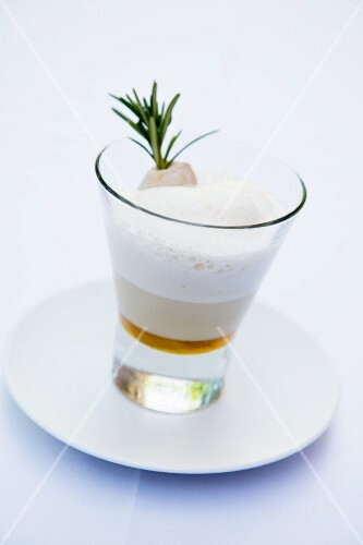 A rosemary cappuccino with a rabbit skewer