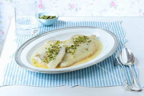 Rombo allo zafferano (turbot with saffron sauce and pistachios, Italy)