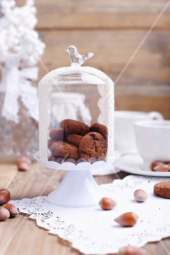 Crispy chocolate and hazelnut biscuits under a glass cloche