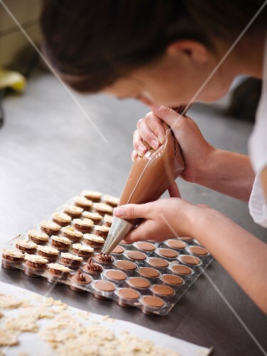 A young woman making pralines, Bernese Oberland, Switzerland
