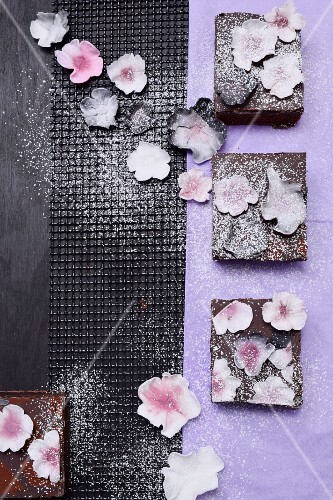 Brownies with white sugar flowers and icing sugar