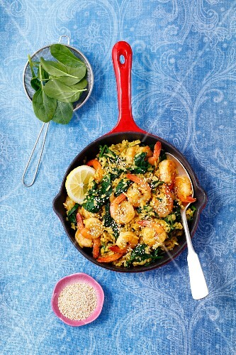 Shrimps with fried rice, spinach, chilli and sesame seeds
