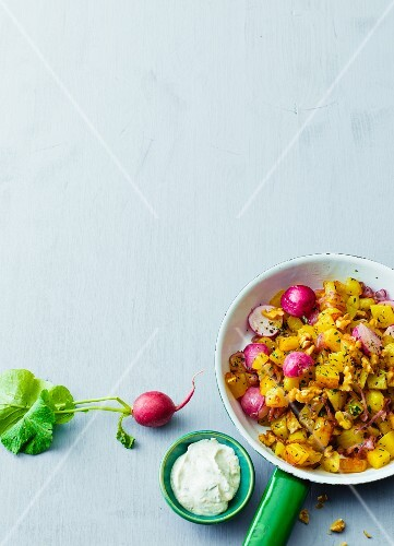 Vegetarian Tyrolean Gröstl (typical Tirolean dish using leftovers) with radishes and walnuts