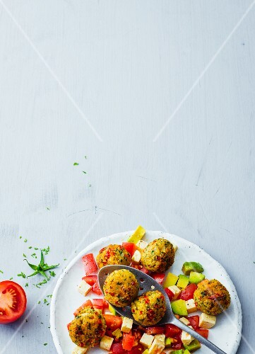 Millet falafel with a tomato and avocado salad