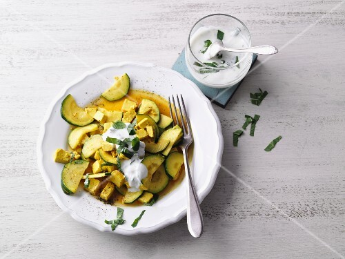 Courgette and tofu curry with natural yoghurt