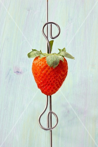 A fresh strawberry on a skewer