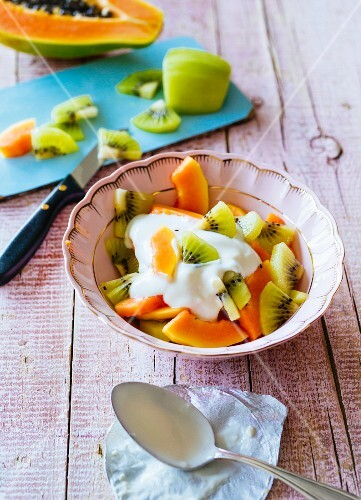 Papaya and kiwi with soya yoghurt and agave syrup