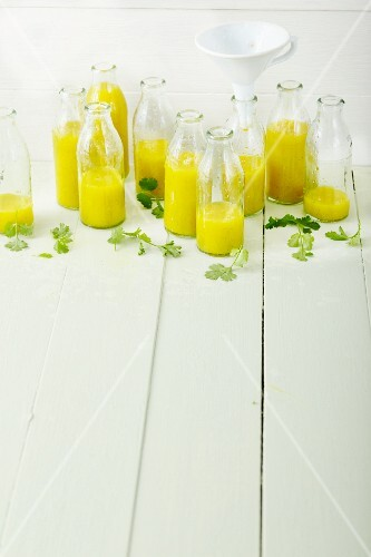 Coriander and turmeric smoothies with fruit and coconut oil
