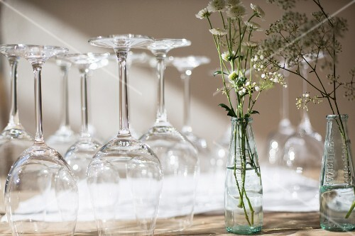 Wine glasses and white flowers