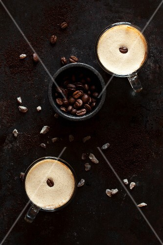 Frothy coffee with coffee beans and brown rock sugar