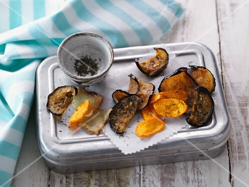 Homemade vegetable crisps made from aubergines, Jerusalem artichokes and carrots