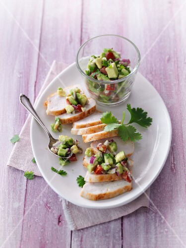 Roasted chicken breast with avocado and tomato salsa