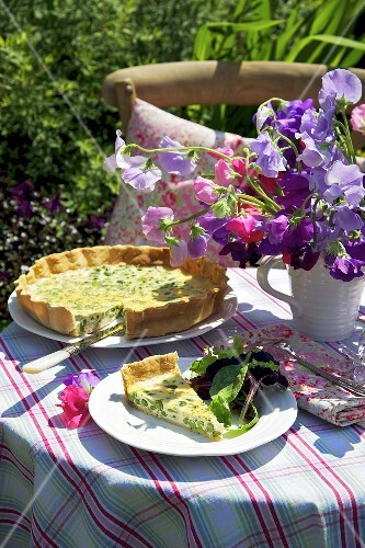 A pea and bean quiche, sliced