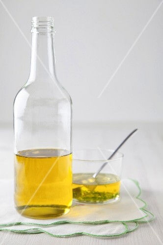 Vinegar in a bottle and in a glass bowl