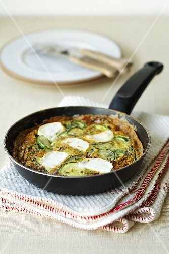 A courgette omelette with goat's cheese in a pan