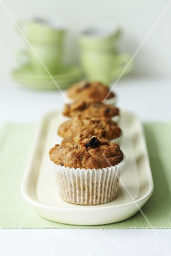 Whole-grain raisin muffins on a serving dish