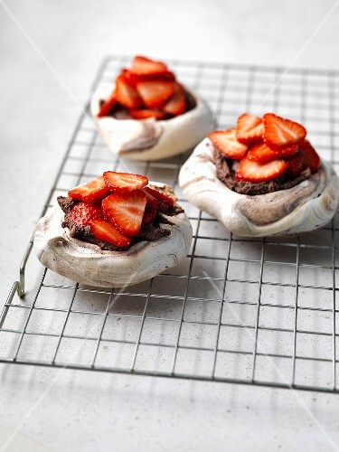Three chocolate meringue tarts with strawberries