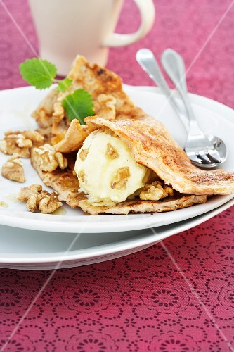 Pancakes with walnuts and walnut ice cream