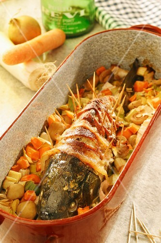 Stuffed carp wrapped in bacon in a butter and port sauce