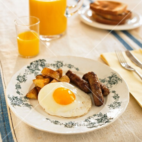 Breakfast Plate with Fried Egg, Sausage and Home Fries; Orange Juice