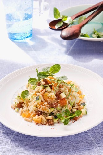 Couscous salad with courgette, dried fruits and pine nuts