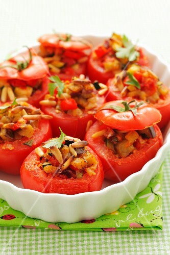 Tomatoes stuffed with ratatouille and pine nuts