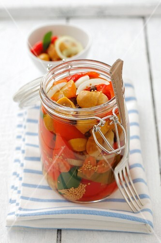 Pickled porcini mushrooms with peppers, carrots and onions