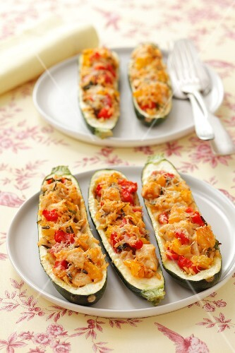 Courgettes filled with chicken, peppers and rice