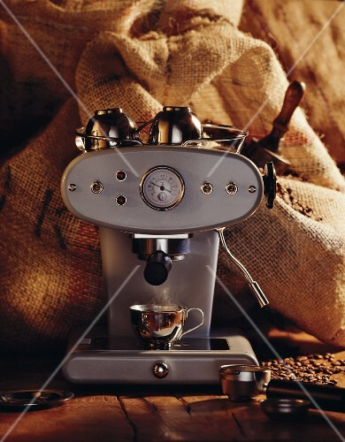 Espresso machine in front of jute sacks