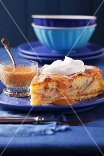 Apple and marzipan cake with caramel sauce and cream