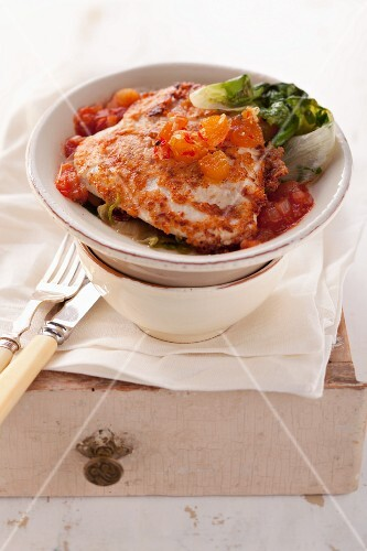 Chicken piccata with tomato sauce and steamed endives