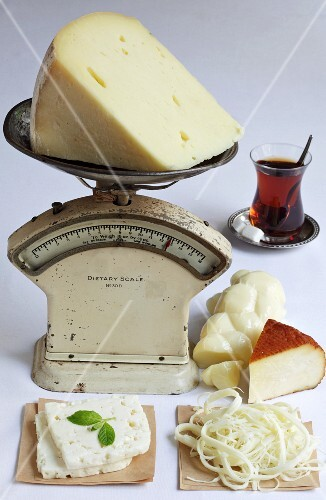 Various types of cheese from Turkey with a pair of kitchen scales