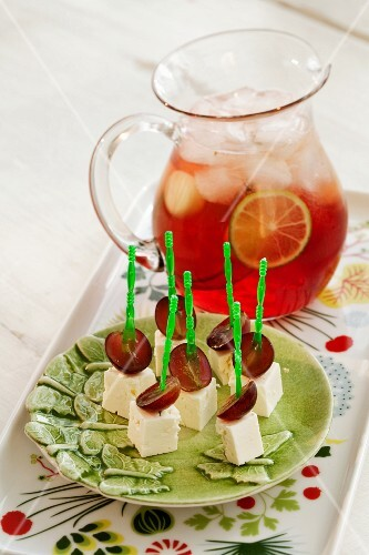 Feta and grape skewers and a jug of punch