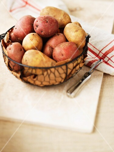 Various potatoes in a wire basket